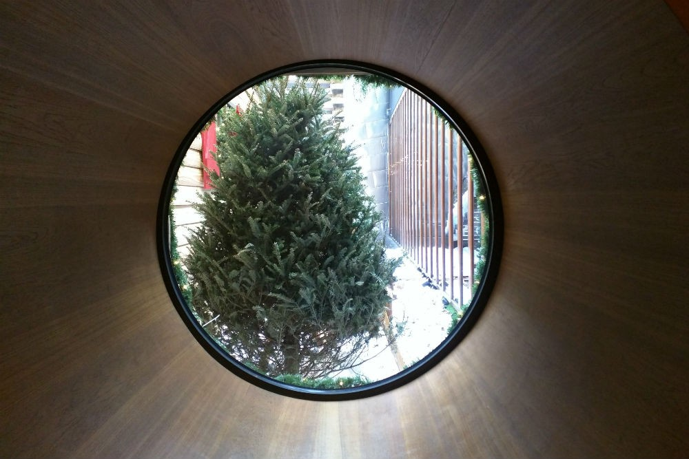 A view through a circular window onto the fake outdoor winter scene, Dream Downtown. Photo: Billie Cohen